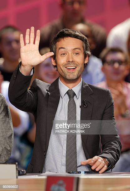 French journalist and TV host Yann Barthes speaks during the recording of 'Le Grand journal' news program on Canal TV channel on November 25 2009 in...
