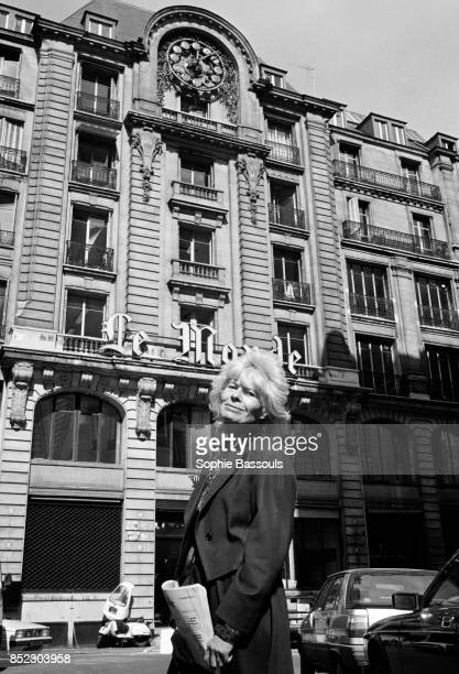 French journalist and writer Claude Sarraute stands across the street from the offices of the newspaper Le Monde Sarraute wrote for Le Monde for many...