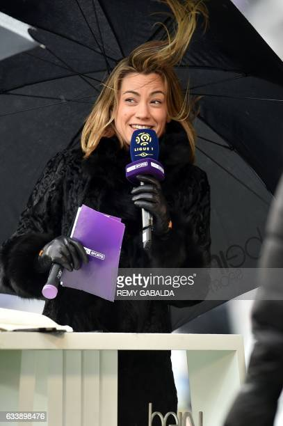 French journalist AnneLaure Bonnet smiles prior to the the French L1 football match between Toulouse and Angers on february 5 2017 at the Municipal...