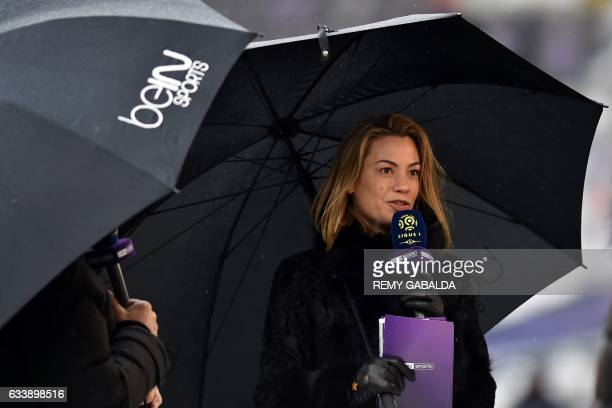 French journalist AnneLaure Bonnet speaks on a microphone prior to the the French L1 football match between Toulouse and Angers on february 5 2017 at...