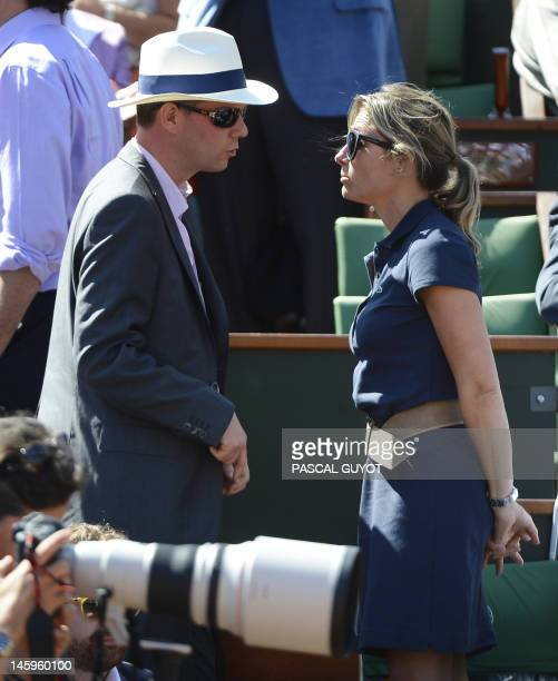 French journalist AnneSophie Lapix talks with Julien Arnaud as they attend a match between Spain's Rafael Nadal and Spain's David Ferrer during the...