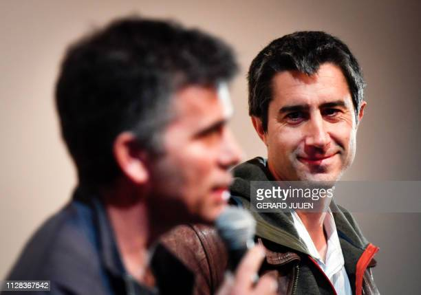 French journalist filmmaker and member of parliament of the leftist La France Insoumise party Francois Ruffin listens to codirector Gilles Perret on...