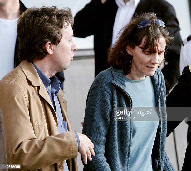 French journalist Florence Aubenas speaks with French former hostage Christian Chesnot upon her arrival at Vélizy-Villacoublay's military airport,...