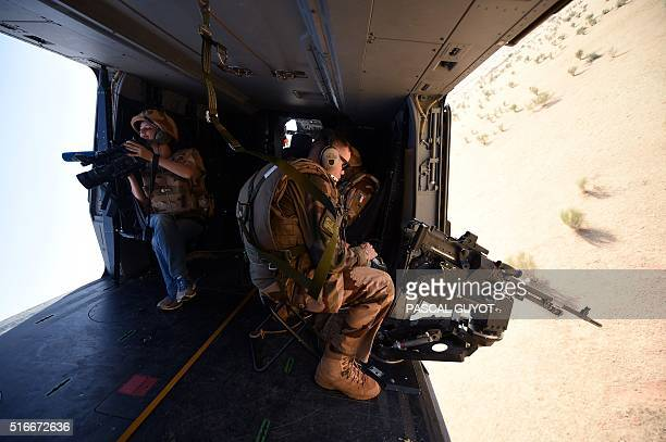 A French journalist from Agence France presse and French soldiers patrol in a helicopter during the operation Barkhane in the Sahel on March 12 2016...