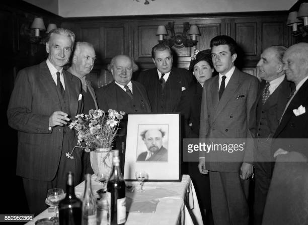 French journalist Henri de Turenne poses in front of a picture of Albert Londres and near the Albert Londres's daughter Florise MartinetLondres after...