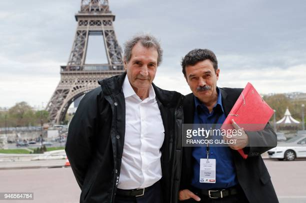 French journalist JeanJacques Bourdin and Mediapart French journalist Edwy Plenel pose in front of the Eiffel Tower as they arrive for an interview...
