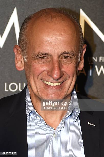 """French journalist Jean-Michel Apatie poses before the premiere of the film """"Mon Roi"""" in Paris on October 12, 2015. AFP PHOTO / DOMINIQUE FAGET"""