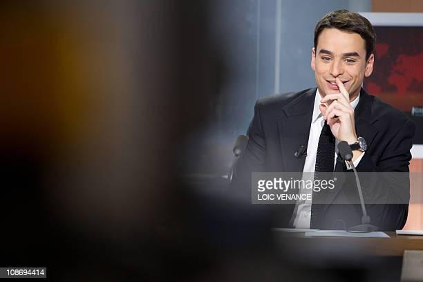 French journalist Julian Bugier hosts the L'info sans interdit TV show on I Tele news channel on January 31 2011 in Paris AFP PHOTO LOIC VENANCE