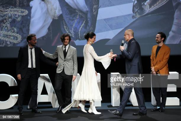 French journalist Laurent Weil greets Canal Plus tv channel's French director of fiction Fabrice de la Patelliere British actors Alexander Vlahos...