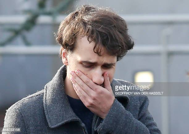 French journalist Loup Bureau reacts as he stands with supporters and family members after addressing media representatives after his arrival at...