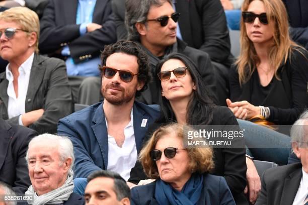 French journalist Marie Drucker and her partner cabinet director of Paris' Mayor Mathias Vicherat attends the men's final match between Britain's...