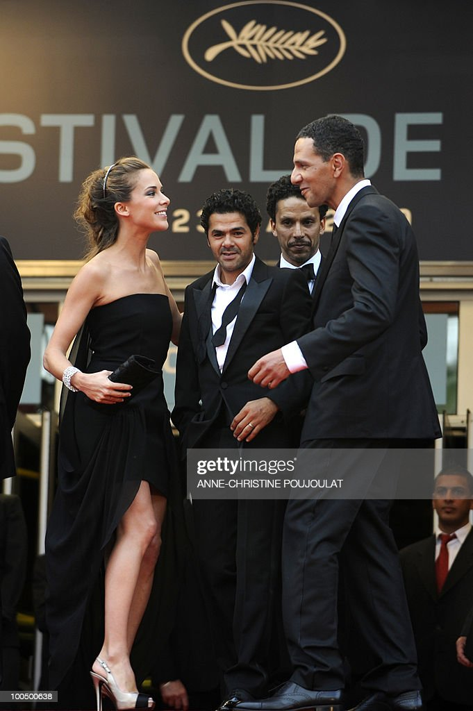 French journalist Melissa Theuriau, her husband French actor Jamel Debbouze, French actor Sami Bouajila and French actor Roschdy Zem arrive for the screening of 'Hors La Loi' (Outside of the Law) presented in competition at the 63rd Cannes Film Festival on May 21, 2010 in Cannes.