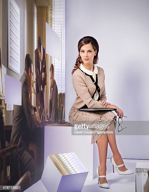108875003 French journalist Melissa Theuriau is photographed for Madame Figaro as Peggy Olson from Mad Men on January 17 2014 in Paris France...