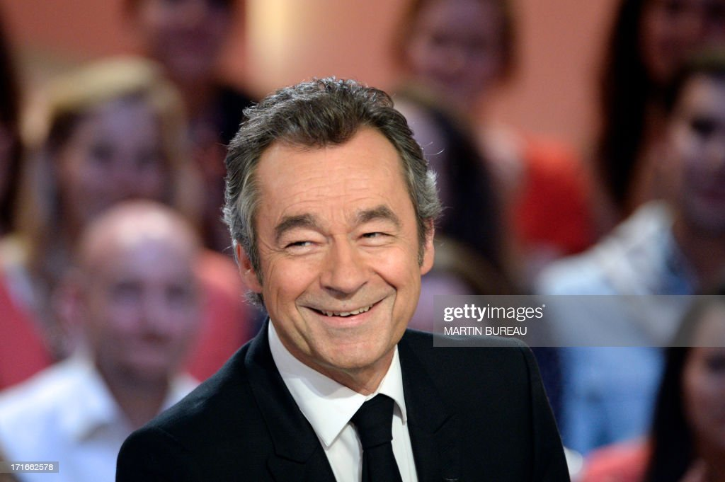 French journalist Michel Denisot smiles on the set of French TV Canal+ talk show 'Le Grand Journal,' he anchored for the last time on June 27, 2013 in Paris.