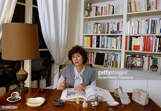 French journalist Michele Cotta sits in her Paris office