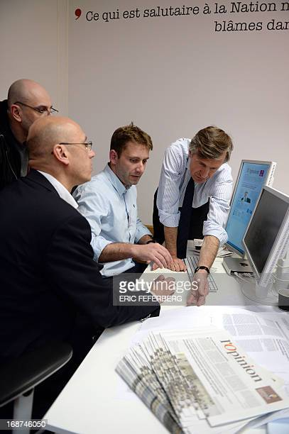 French journalist Nicolas Beytout speaks with collaborators during the preparation of the first edition of this daily newspaper L'Opinion on the eve...