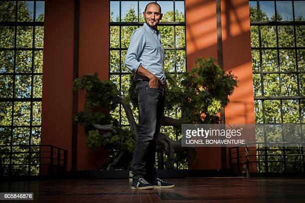 French journalist radio and TV host Karim Rissouli poses at La Cite du Cinema in SaintDenis on September 13 2016 / AFP / LIONEL BONAVENTURE