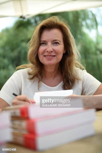 French journalist Valerie Trierweiler signs books during the 22th La Foret Des Livres book fair on August 27 2017 in ChanceauxpresLoches central...