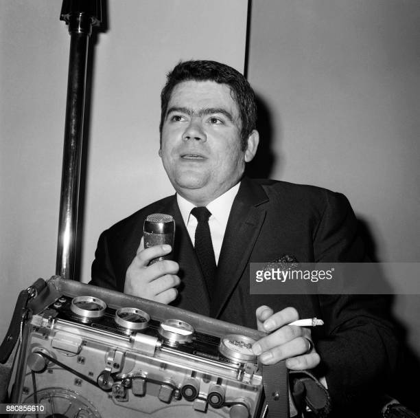 French journalist Yves Courrière of Nice Matin poses with his audio recorder after winning the 1966 Albert Londres prize on May 16 in Paris / AFP...