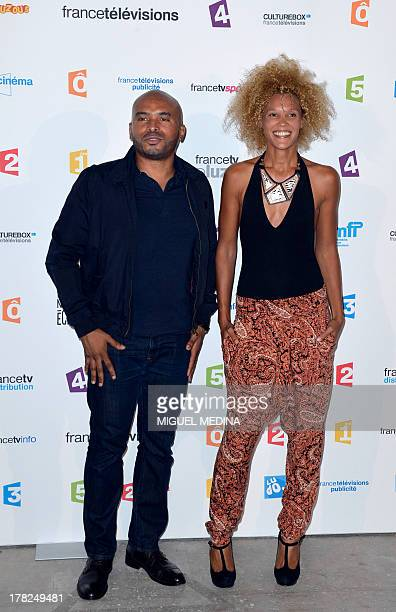 French journalists Ali Rebeihi and Amanda Scott pose during a photocall following the France Televisions new season press conference at the Palais de...