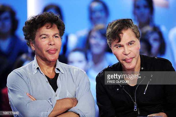 French journalists Igor and Grichka Bogdanov take part in the Le Grand Journal TV show on a set of Canal French TV group in Paris on October 20 2010...