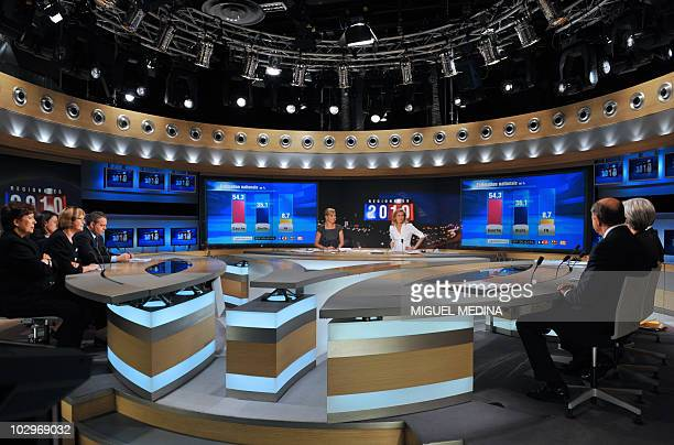 French journalists Laurence Ferrari and Claire Chazal ask questions to her guests on the set of French television channel TF1 during a special...
