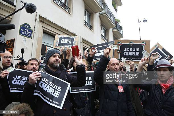 French journalists observe a minute's silence at noon close to the Charlie Hebdo offices on a day of mourning following a terrorist attack in the...