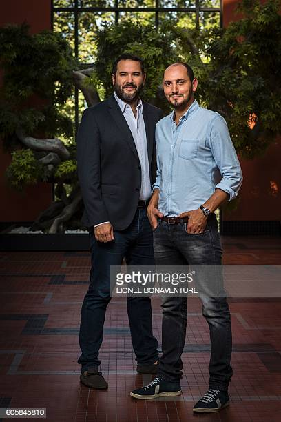 French journalists radio and TV hosts Bruce Toussaint and Karim Rissouli pose at La Cite du Cinema in SaintDenis on September 13 2016 / AFP / LIONEL...