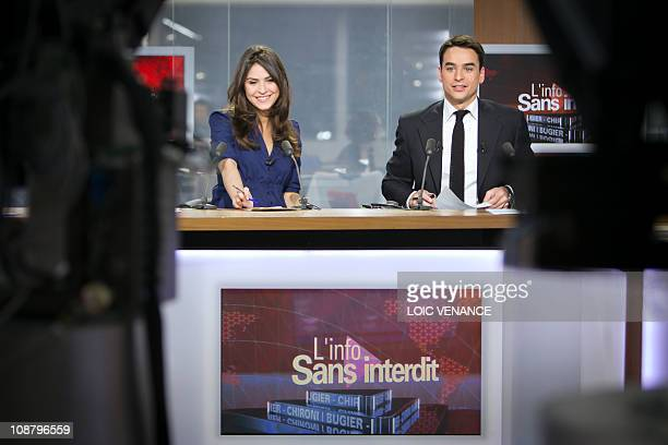 French journalists Sonia Chironi and Julian Bugier host the L'info sans interdit TV show on I Tele news channel on January 31 2011 in Paris AFP PHOTO...