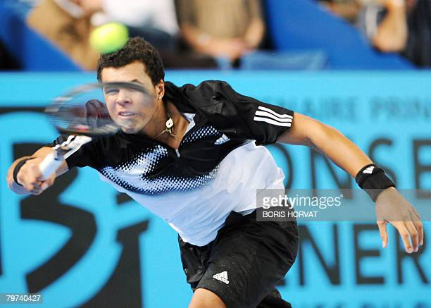 French Jo-Wilfrid Tsonga hits a forehand shot to Croatian Mario Ancic during their Open 13 tennis tournament first round match on February 13, 2008...