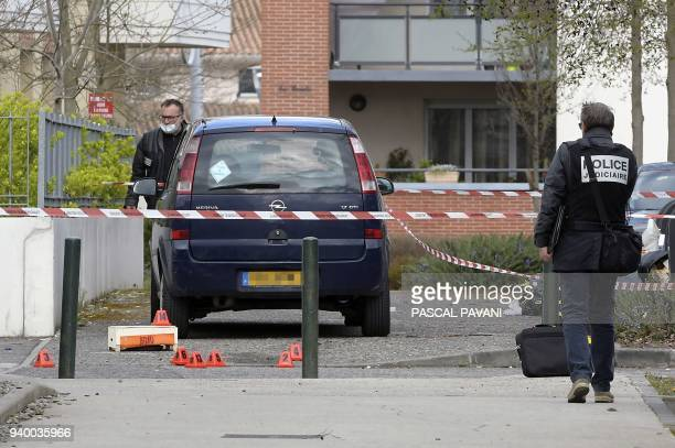 French judiciary police officers work near the site where Rahim Namazov an Azerbaijani journalist living in exile in France and his wife were...