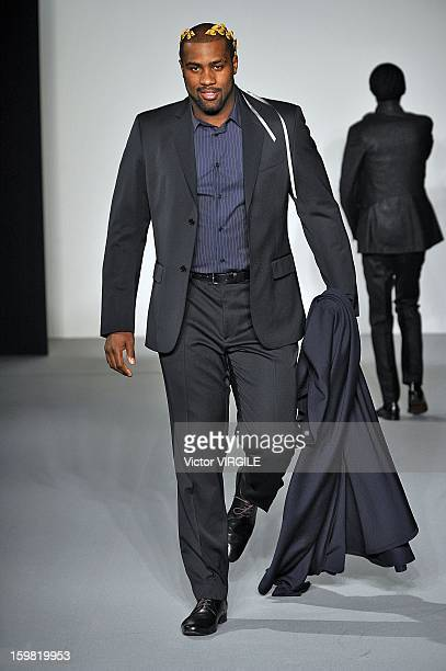 French judo champion Teddy Riner walks the runway during the Agnes B Men Ready to Wear Fall/Winter 20132014 show as part of Paris Fashion Week on at...
