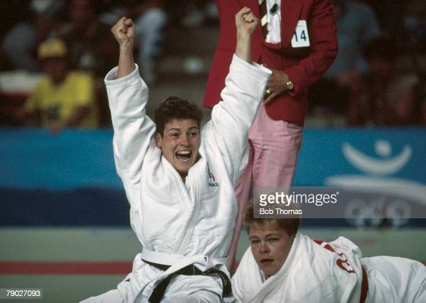 French judoka Nathalie Lupino celebrates her victory over Claudia Weber of Germany to win the bronze medal in the Womens 72kg Judo event at the 1992...
