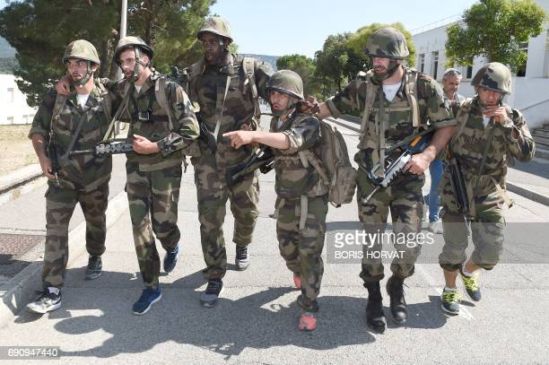 French judoka Teddy Riner and teammates take part in a physical training camp supervised by servicemen at the first regiment of the French Foreign...