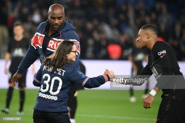 French judoka Teddy Riner , Paralympic judoka Sandrine Martinet speaks with Paris Saint-Germain's French forward Kylian Mbappe prior to the French L1...