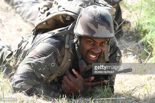 TOPSHOT French judoka Teddy Riner takes part in a physical training camp supervised by servicemen at the first regiment of the French Foreign Legion...