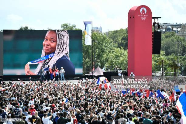 French Judoka, women's +78kg bronze medalist and mixed team Olympic champion, Romane Dicko is seen on a screen at the fan village of The Trocadero in...