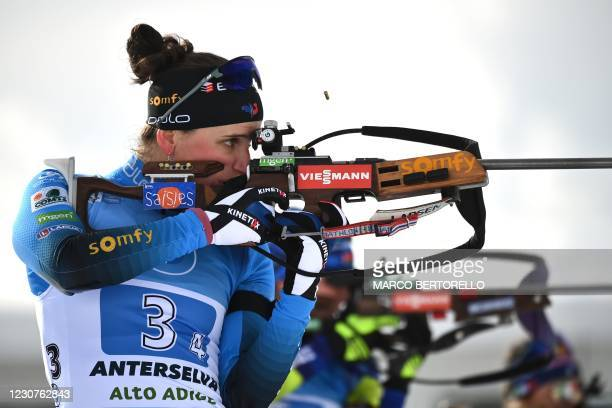 French Julia Simon competes at the shooting range during the IBU Biathlon World Cup Women's 4 X 6 km Relay Competition in Antholz-Anterselva, Italian...