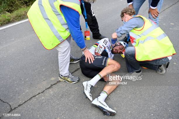 French Julian Alaphilippe of Deceuninck - Quick-Step lays on the ground after a fall at the 'Ronde van Vlaanderen - Tour des Flandres - Tour of...