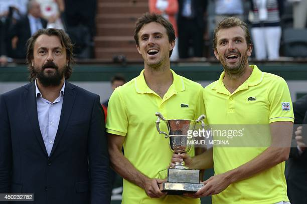 French Julien Benneteau and Edouard RogerVasselin pose with French former player Henri Leconte after winning the French tennis Open men's double...