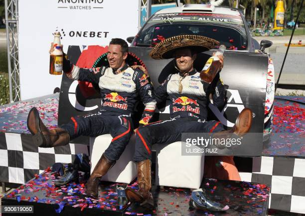 TOPSHOT French Julien Ingrassia and Sebastian Ogier wearing the traditional boots and charro hat celebrate after winning the 2018 FIA World Rally...