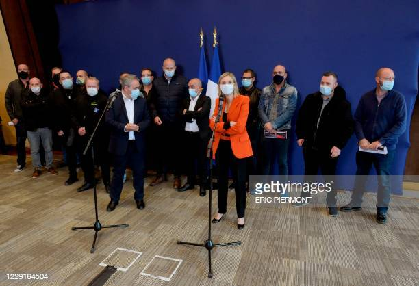 French Junior Industry Minister Agnes Pannier-Runacher talks flanked by the President of France's Hauts-de-France region Xavier Bertrand and...