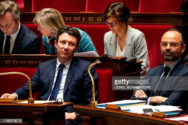 French Junior Minister and Government's spokesperson Benjamin Griveaux and French Prime Minister Edouard Philippe look on during a session of...
