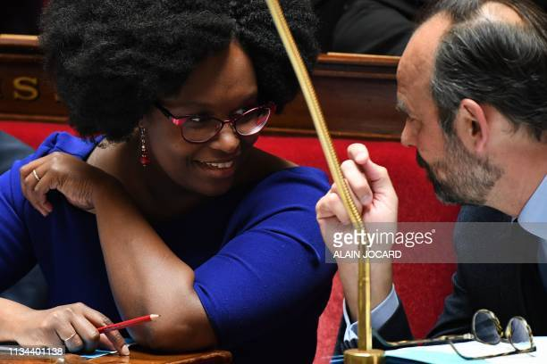 French Junior Minister and Government's spokesperson Sibeth NDiaye speaks and laughs with French Prime Minister Edouard Philippe during a session of...