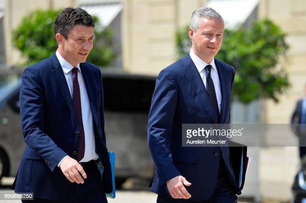 French junior Minister Benjamin Griveaux and French Economy Minister Bruno Le Maire leave the Elysee Palace after the weekly cabinet meeting with...