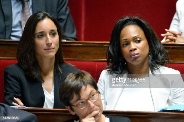 French junior minister Brune Poirson and French Minister of Sports Laura Flessel react as Ministers answer deputies during the weekly questions to...
