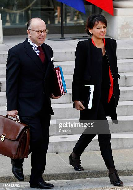 French Junior Minister for Budget Bernard Cazeneuve and Minister for Women's Rights and Government Spokesperson Najat VallaudBelkacem leave after the...
