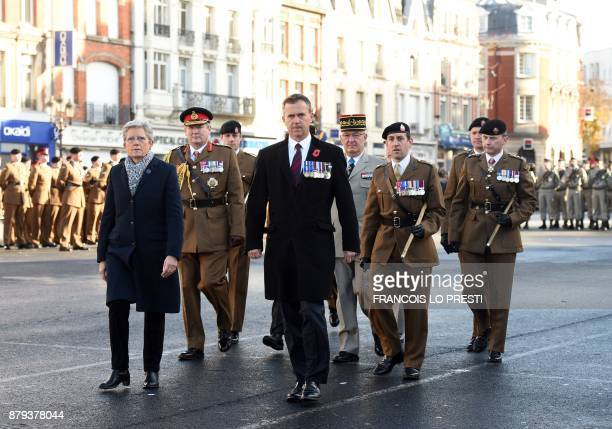 French Junior Minister for Defence Genevieve Darrieussecq Britain's Minister of State for the Armed Forces Mark Lancaster and French General Thierry...