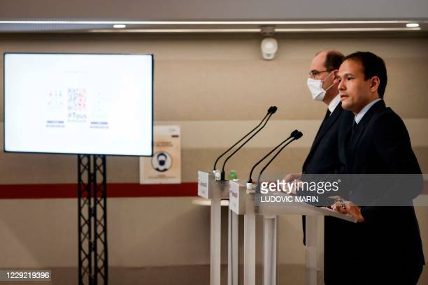 French Junior Minister for Digital Transition and Electronic Communication Cedric O delivers a speech, next to French Prime Minister Jean Castex...