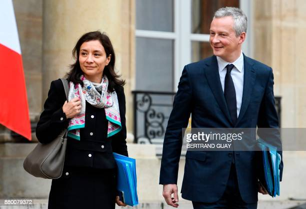 French Junior Minister for Economy Delphine GenyStephann and French Economy Minister Bruno Le Maire leave the Elysee palace following the weekly...